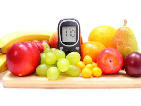 A table with fruit and an electronic counter device - What is the role of CHOs in the management of diabetes?