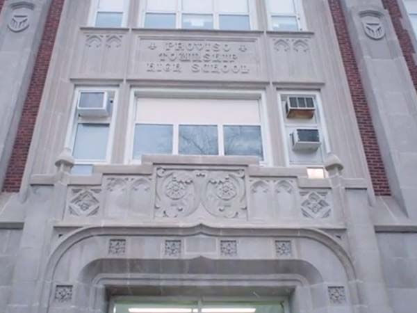 Image of the front of a high school from the Lunch Brunch video.