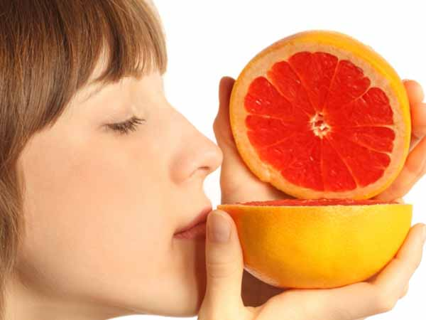 "Woman smelling grapefruit - RDNs as ""Sommeliers"" for Healthful Food"
