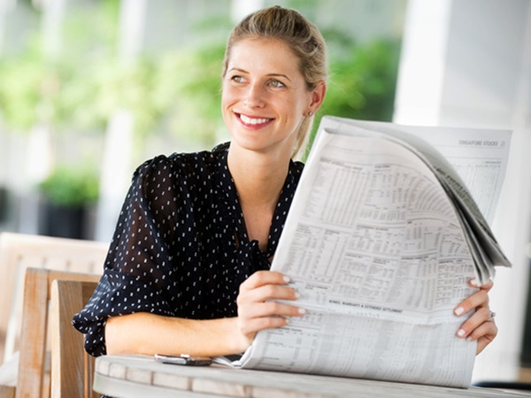 Woman reading the newspaper - How to Write a Letter to the Editor