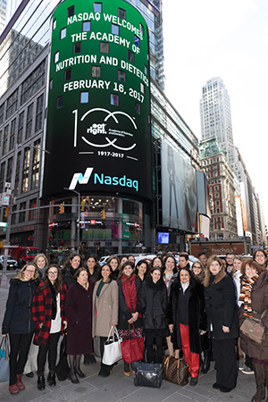 Academy Members Outside of Academy and NASDAQ display in Times Sqaure